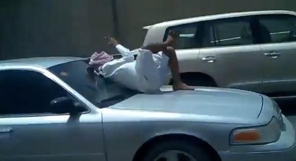 Saudi Man texts on bonnet Speeding car Insurance must be expensiveth_