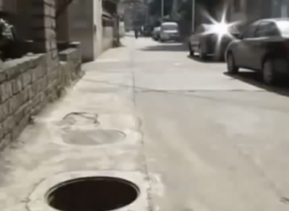 Security camera catches a Chinese man trying to murder his girlfriend by shoving her down a manhole11