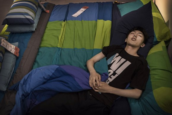 Bizarre photos of Chinese shoppers napping at Ikea7
