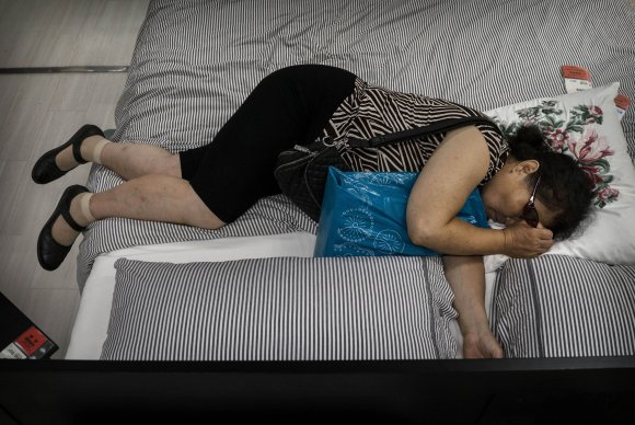 Bizarre photos of Chinese shoppers napping at Ikea8