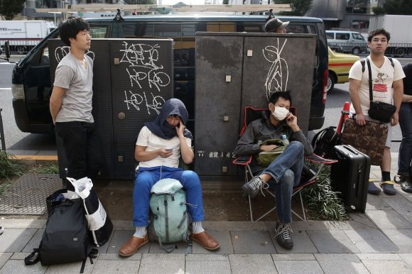 some-people-in-japan-had-luggage-with-them-they-must-have-been-waiting-in-line-for-a-while