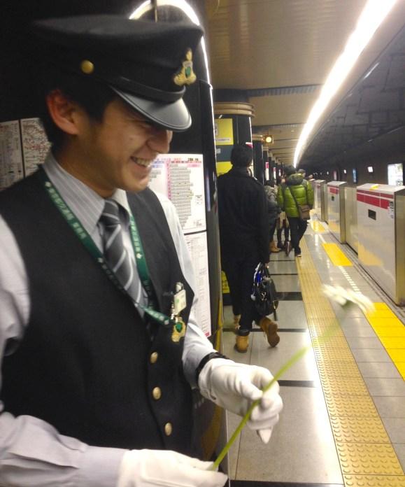 Daisuke Tokyo Metro subway worker, with gerbera flower, Alice, Lee Mingwei, The Moving Garden art installation