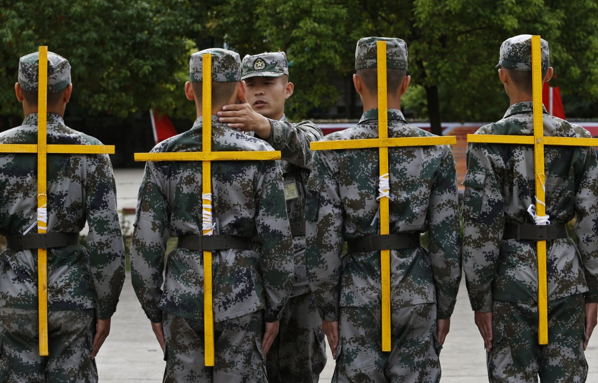 a-similar-drill-involves-marching-with-a-cross-tied-to-your-back-it-is-all-part-of-reaching-a-military-posture