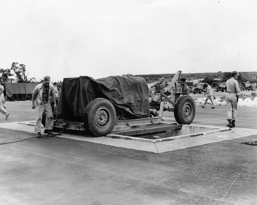 at-the-airfield-fat-man-is-lined-up-over-a-pit-specifically-constructed-for-it-from-which-it-is-then-loaded-into-the-plane-that-dropped-it-over-nagasaki-on-august-9-1945 (1)
