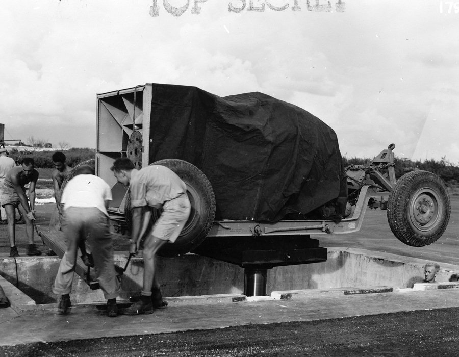 the-bomb-and-its-trailer-are-lowered-down-into-the-pit-using-a-hydraulic-lift